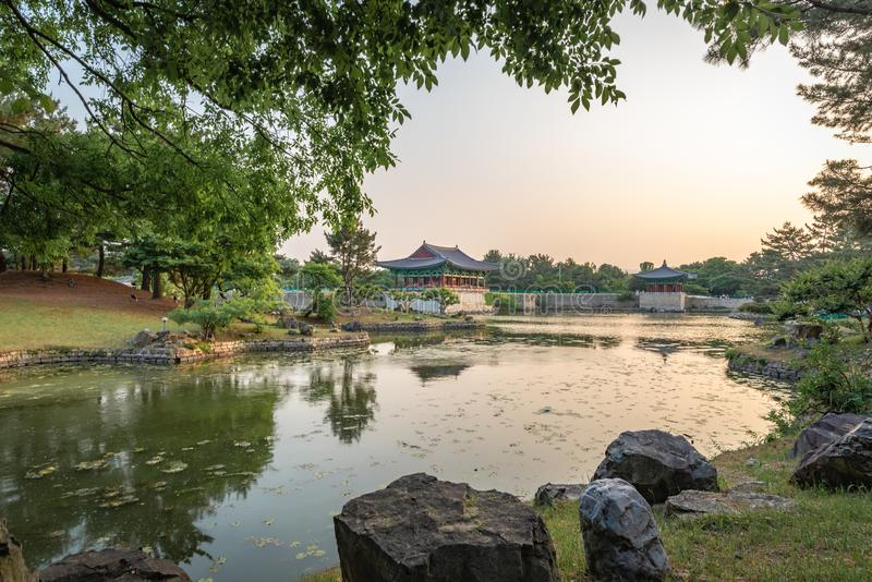 Framed view of one pavilion of the Donggung Palace and the Wolji Pond. Shot at sunset, Gyeongju, South Korea royalty free stock photo