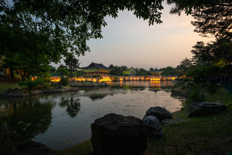 Framed view of two pavilions of the Donggung Palace reflecting into  the Wolji Pond. Shot at dusk, Gyeongju, South Korea stock photos