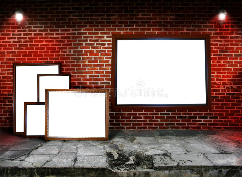 Frames. Assorted frames stacked and hung along a brick wall. Concept for art show stock photo