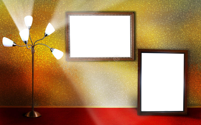 Frames. Two frames along a textured wall with red carpeted flooring and a multi-heading light shining light within the room stock image