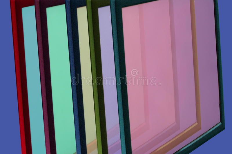 Frames With Colorful Glass. Stacked frames with color glass inside stock photography