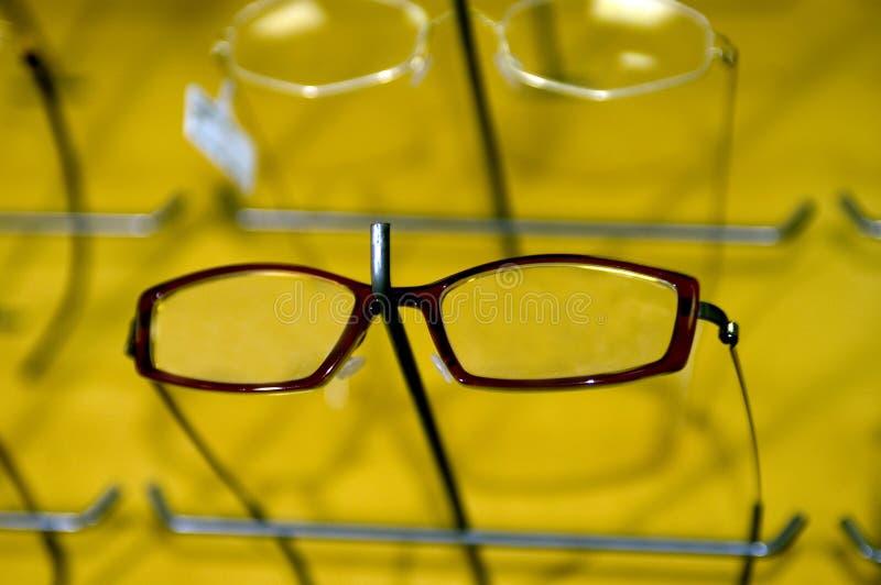 Frames de Eyeglasse no indicador de parede foto de stock royalty free