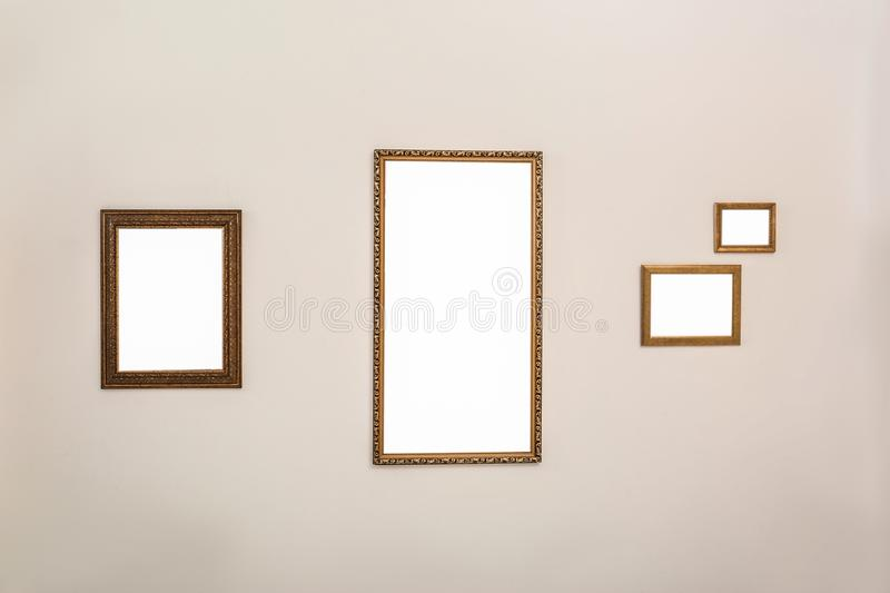 Frames with empty canvases on wall in modern art gallery. royalty free stock photo