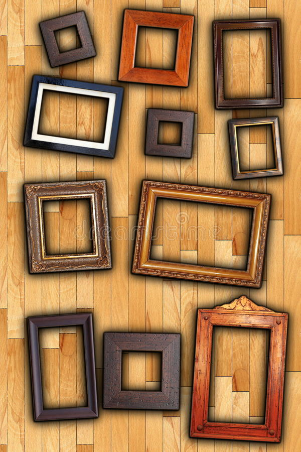 Frames on wall backdrop. Old painting wooden frames on wall backdrop royalty free stock photos