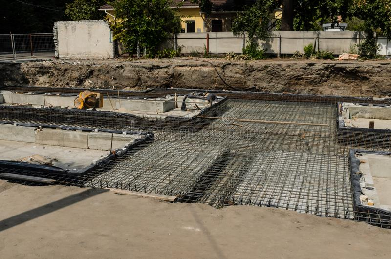 Framework for the foundation of the building. Framework for the concrete foundation of new building stock images