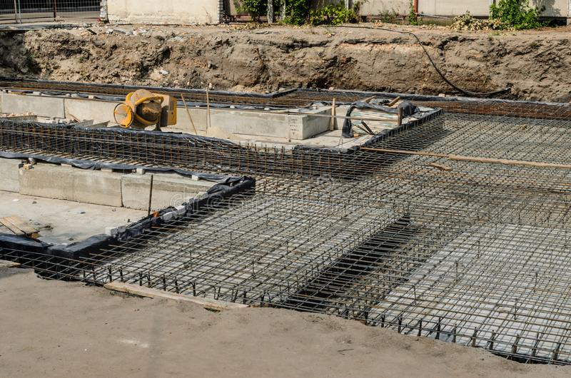 Framework for the foundation of the building. Framework for the concrete foundation of new building royalty free stock photography