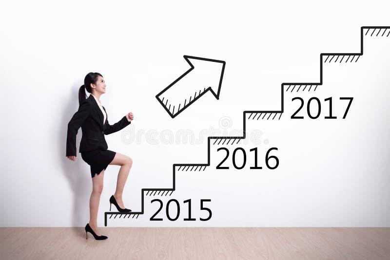 Framgång för affärskvinna i nytt år royaltyfri bild