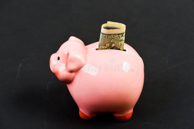 Framgång i finans och kommers f? rikt inkomst piggy s?ttande sparande f?r grupppengar Aff?rsstart finansiell position Familjbudge royaltyfria foton