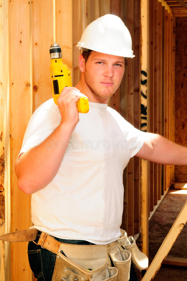 Framing Contractor. Inside A New Home Holding A Power Drill stock photography