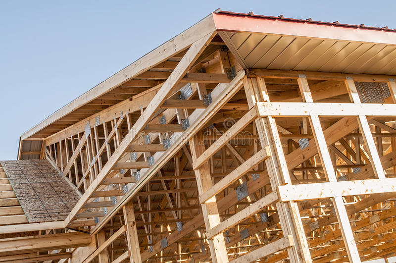 Framing new wooden building structure construction stock photography