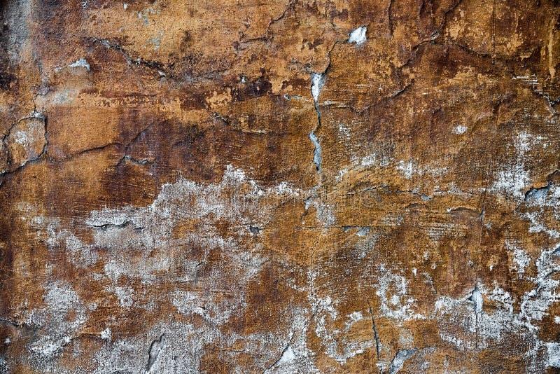 Frammento della parete invecchiata con struttura di sollievo, fondo nella tecnica di lerciume immagini stock libere da diritti