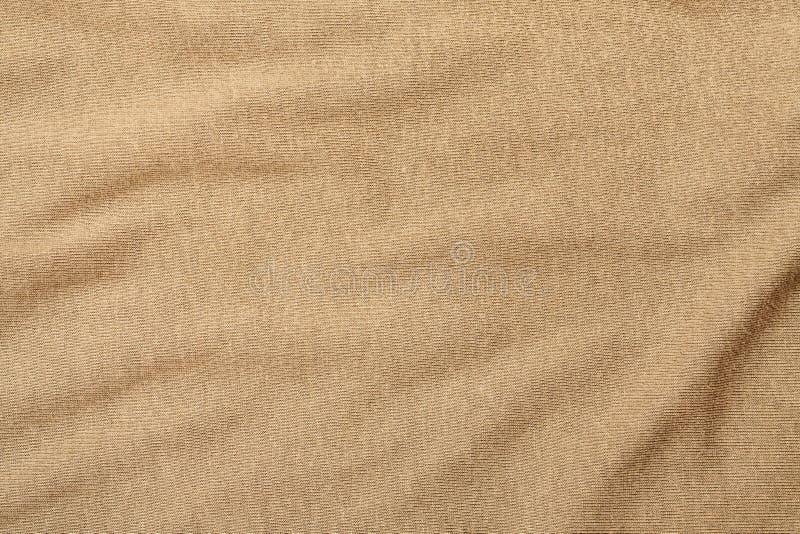 Frammento verde corrugato del tessuto di cotone, struttura astratta fotografia stock