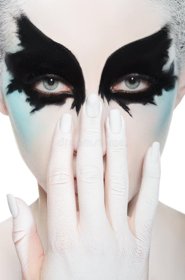 Framsida av den härliga kvinnan, svartvit makeup arkivbilder