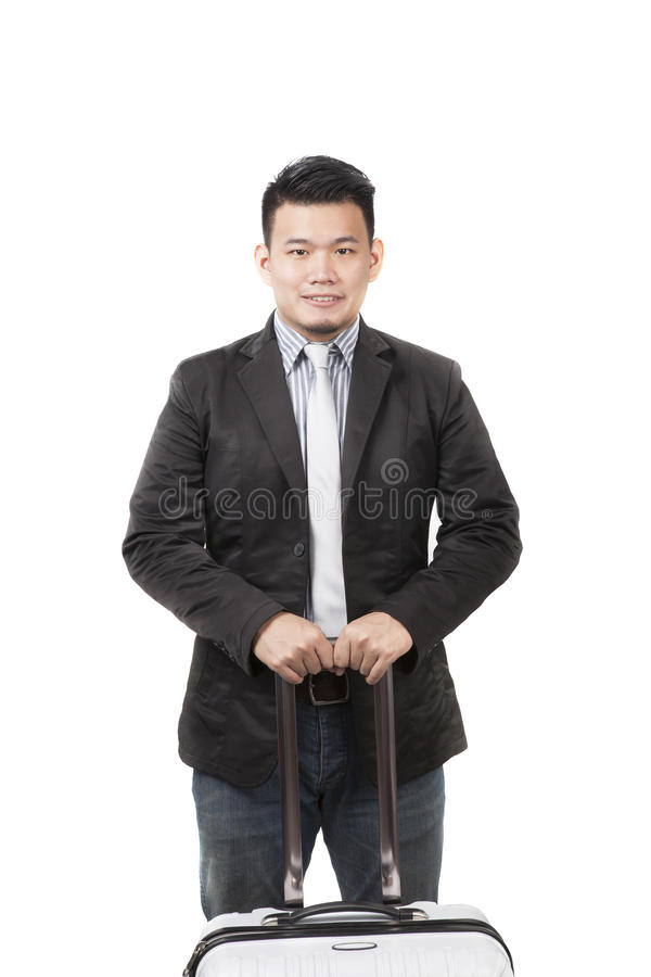 Framsida av den unga asiatiska mannen med ett bagage för behållaren som hör hemma s royaltyfria bilder