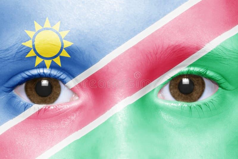 framsida med den namibian flaggan royaltyfri bild