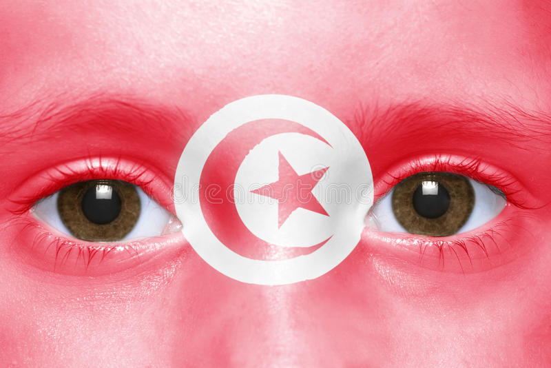 Framsida med den tunisian flaggan royaltyfria bilder