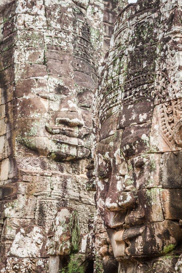 Framsidor av den Bayon templet i Angkor Thom, Siemreap, Cambodja royaltyfri foto
