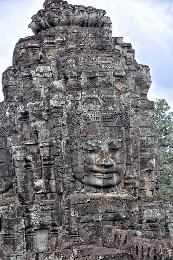 Framsidor av den forntida Bayon templet i Siem Reap royaltyfri fotografi