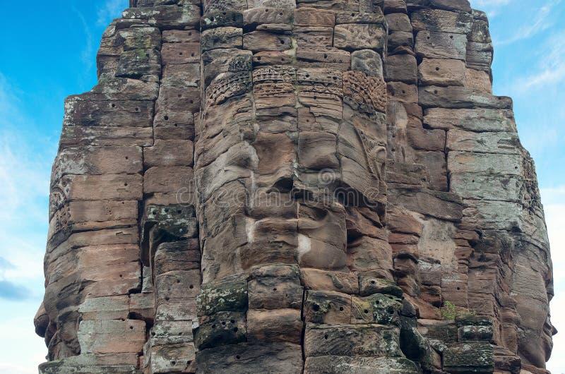 Framsidor av den forntida Bayon templet på Angkor Wat, Siem Reap, Cambodja royaltyfria foton