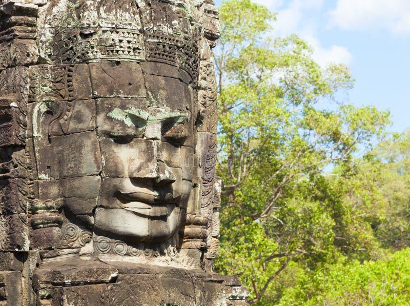 Framsidor av det Bayon tempelet royaltyfria foton