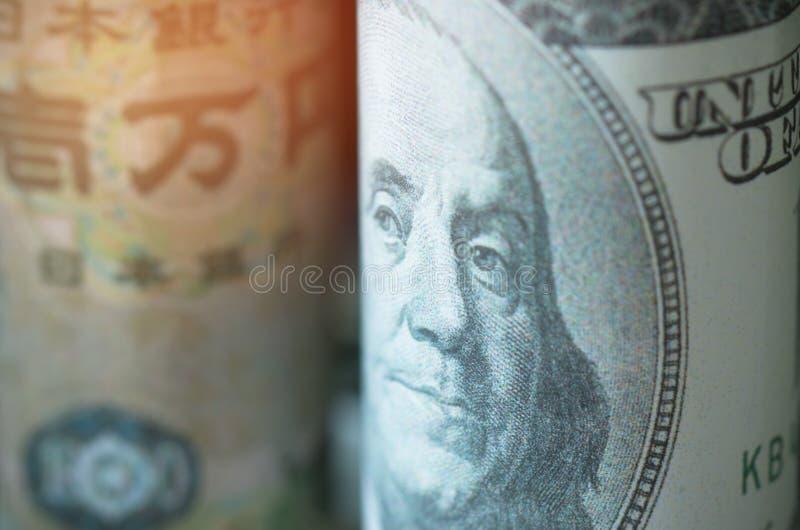 Framsidor av ledareUS dollar, japansk yen, sedelvalutor av arkivbilder