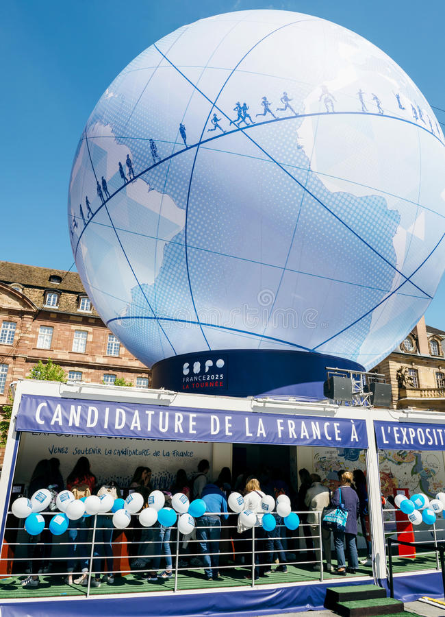 France Candidacy for World Fair 2025 - people admiring globe. STRASBOURG, FRANCE - MAY 4, 2016: Urban pavilion in central square installed to promote the stock image