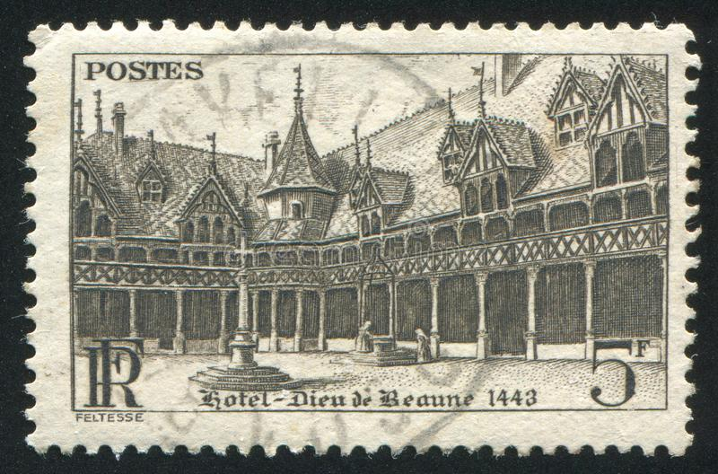 Beaune Hospital. FRANCE - CIRCA 1941: stamp printed by France, shows Beaune Hospital, circa 1941 stock photos