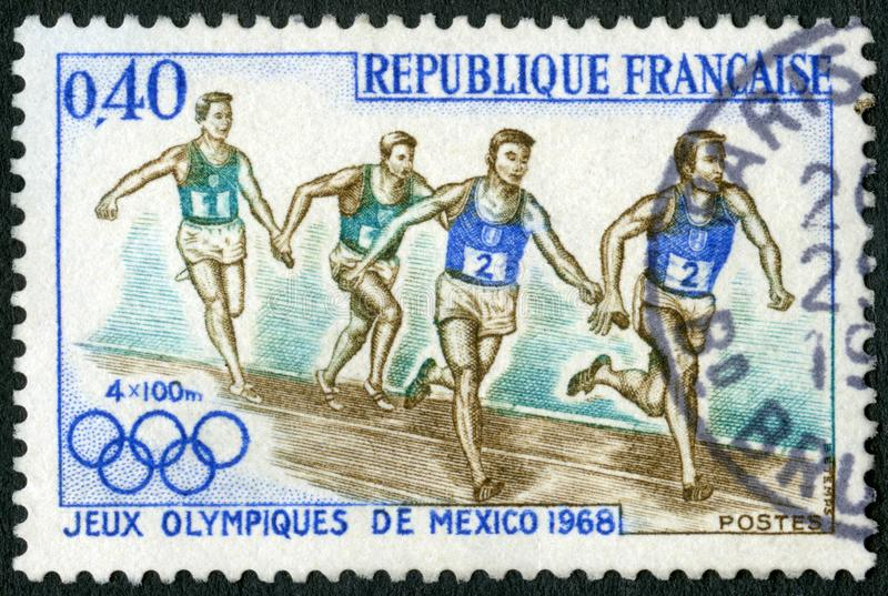 FRANCE - 1968: shows Relay Race, 19th Olympic Games, Mexico City. FRANCE - CIRCA 1968: A stamp printed in France shows Relay Race, 19th Olympic Games, Mexico royalty free stock photos