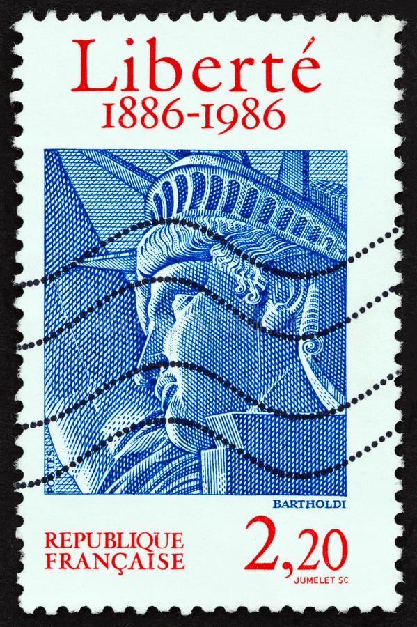 FRANCE - CIRCA 1986: A stamp printed in France shows Head of Statue of Liberty, circa 1986. FRANCE - CIRCA 1986: A stamp printed in France issued for the royalty free stock images
