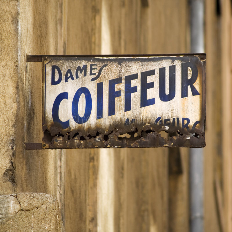 France coiffeur stary znak zdjęcie stock
