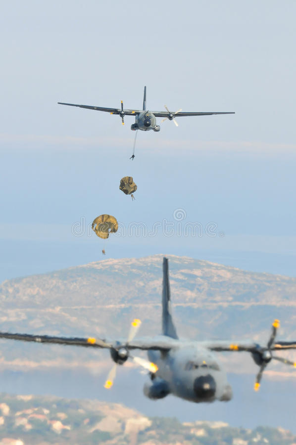 France, Corsica, Calvi, - circa, 2011.Transport aircraft with the legionaires in the sky carry out the assault landing. royalty free stock photos