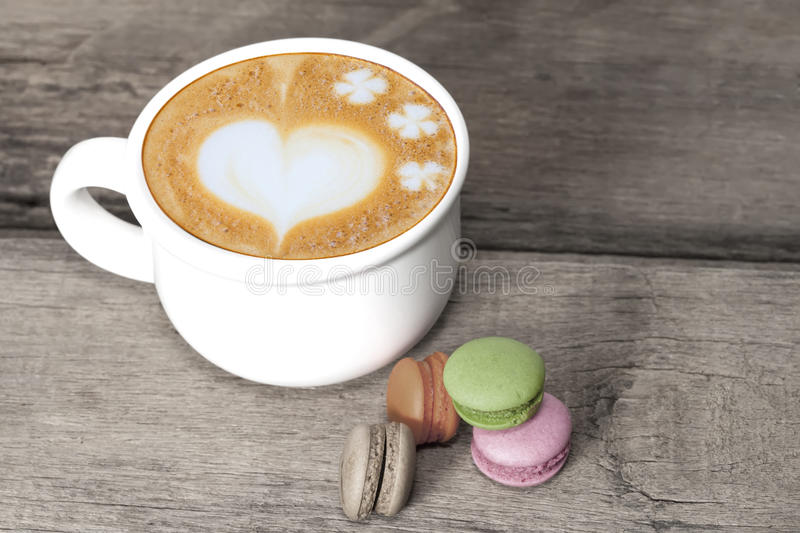 France dessert macaroons and latte art coffee royalty free stock photos