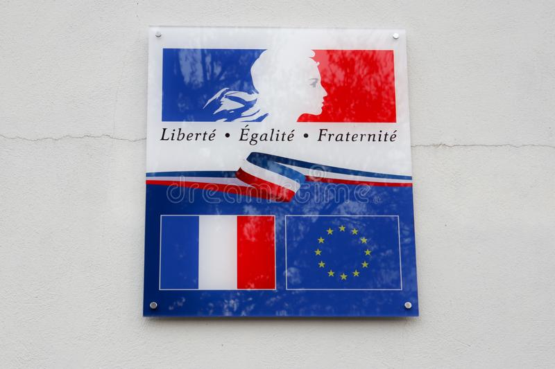France and europe flag with writing liberte egalite fraternite means in french freedom equality fraternity. The france and europe flag with writing liberte stock images