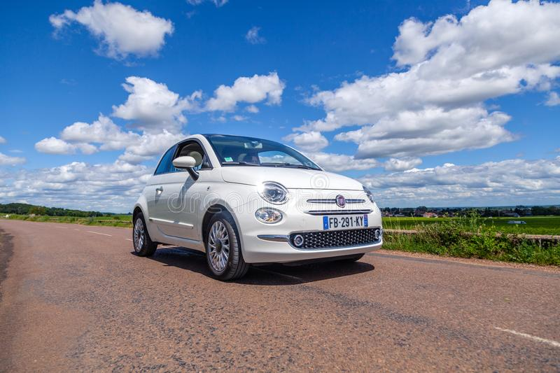 France Lyon 2019-06-20 closeup front view small compact white car hatchback Fiat 500 on the background of nature, beautiful royalty free stock photos