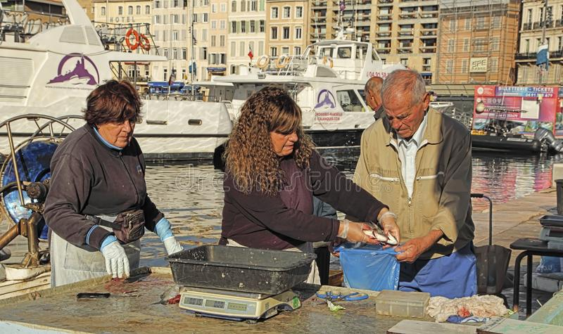 France, Marseille -November 19, 2018: The buyer at the fish market in Marseille.  Old Port of Marseille Vieux-Port, Marseille is stock photos