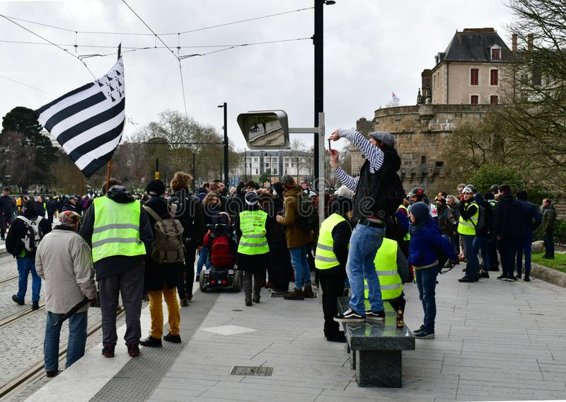 France, Nantes - February 9, 2019: Protest action of the `yellow vests` on the Allée du Port Maillard. The movement of `yellow vests` is rapidly gaining stock images