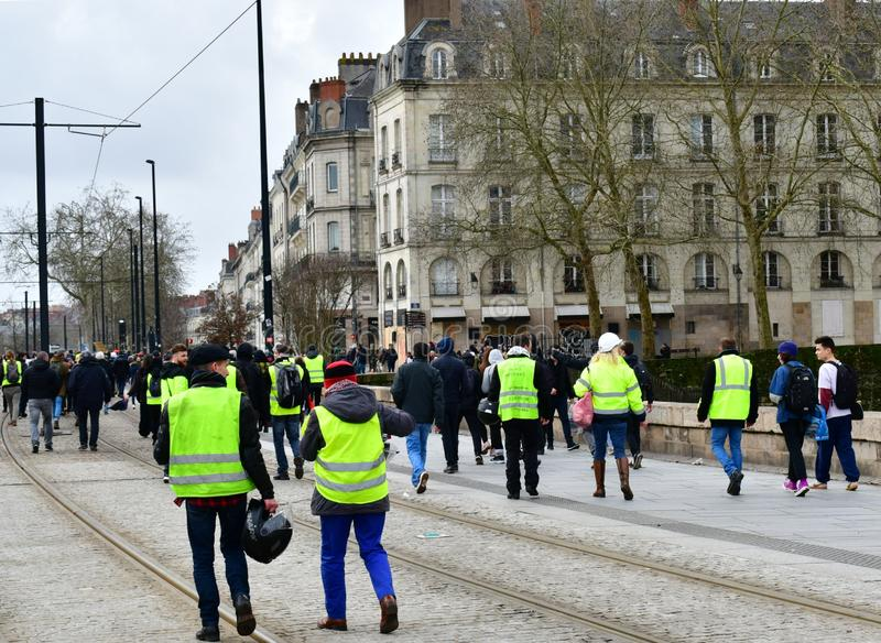 France, Nantes - February 9, 2019: Protest action of the `yellow vests` on the Allée du Port Maillard. The movement of `yellow vests` is rapidly gaining royalty free stock photos