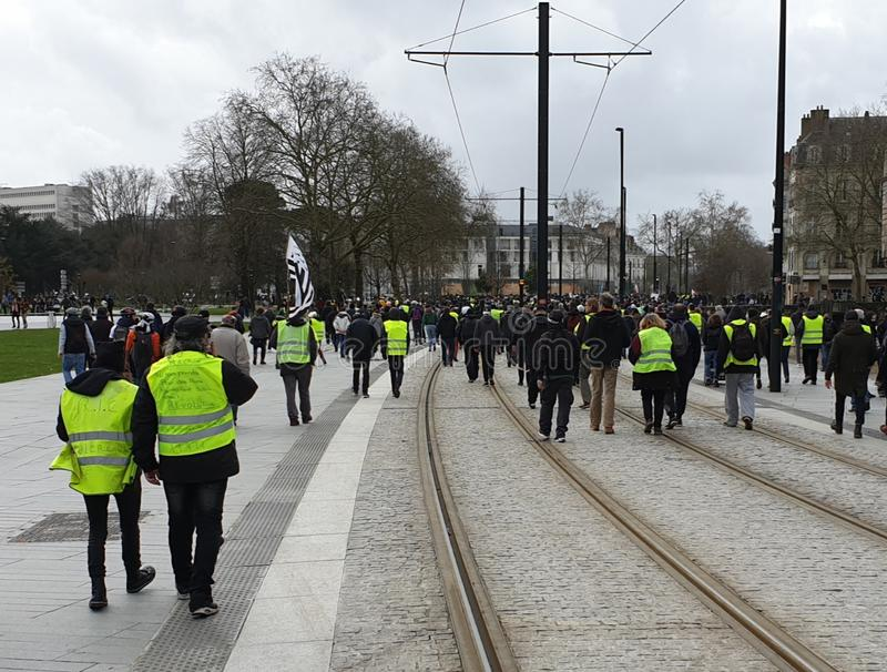 France, Nantes - February 9, 2019: Protest action of the `yellow vests` on the Allée du Port Maillard. The movement of `yellow vests` is rapidly gaining royalty free stock image