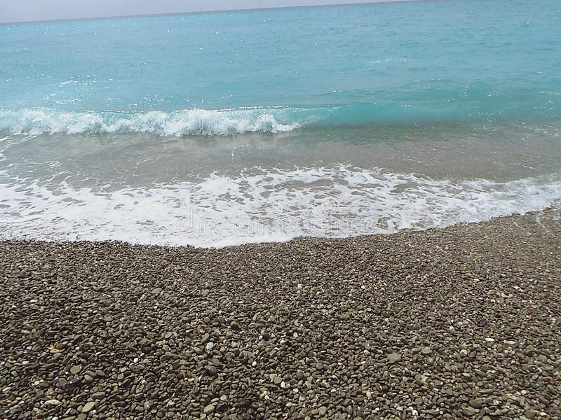 France Nice Cote d Azur pebbles beach sea waves. Detail stock photography
