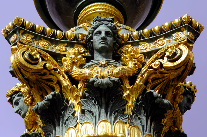 France; Paris;lampe at the place de la concorde. France; Paris; Detail of a street lampe; nice bronze detail of a lamp in bronze and golden leaves at the stock photo