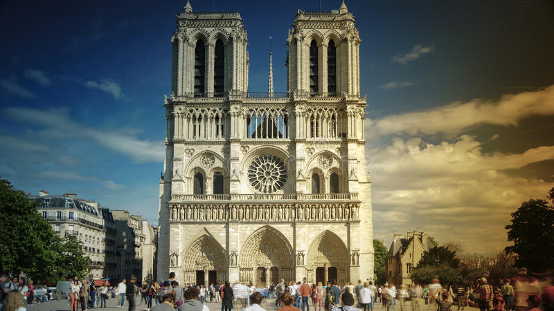Tourists visiting the Cathedrale Notre Dame de Paris is a most famous cathedral 1163 - 1345 on the eastern half of the Cite Isla stock photo
