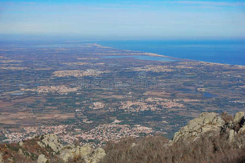France Roussillon plain and Mediterranean sea. France the Roussillon plain on the shore of the Mediterranean sea, Pyrenees Orientales, landscape from the heights stock photography