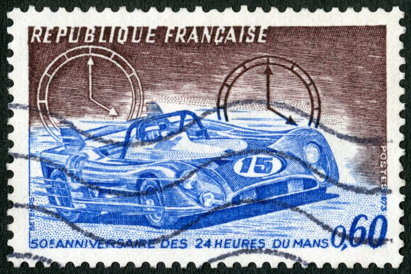 FRANCE - 1973: shows Racing Car and Clocks, 24 hour automobile race at Le Mans, 50th anniversary royalty free stock photo