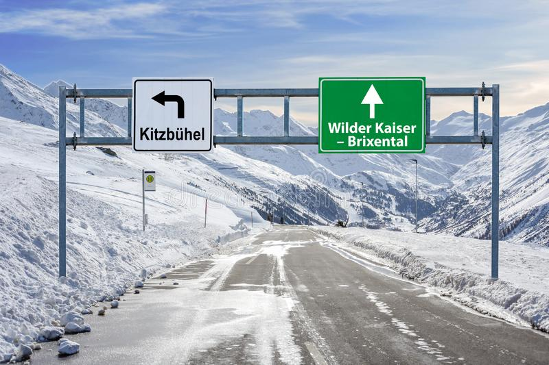 France ski town Kitzbuhel and Wilder Kaiser - Brixental road big sign with a lot of snow and mountain sky. Close royalty free stock image