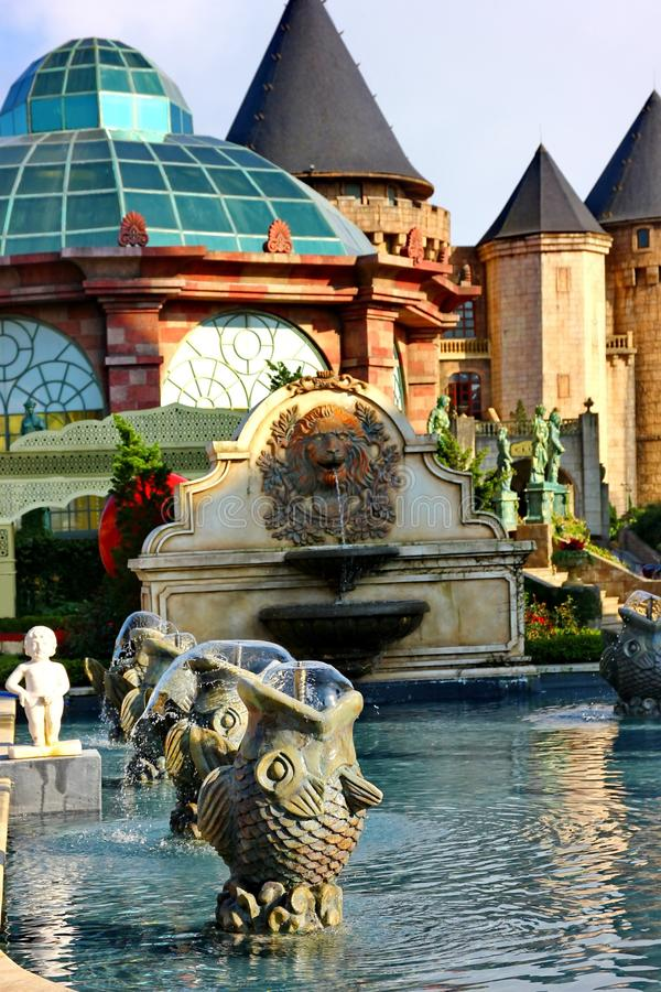 Fish fountain in the France village style . Fish fountain in the France village style is beautiful and passion architecture stock images