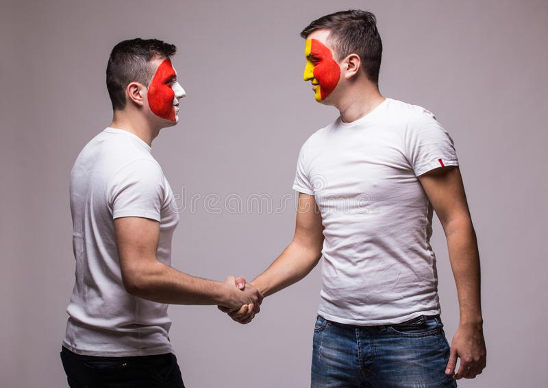 France vs Romania. Football fans of national teams handshak. E before match on grey background. football fans concept royalty free stock images
