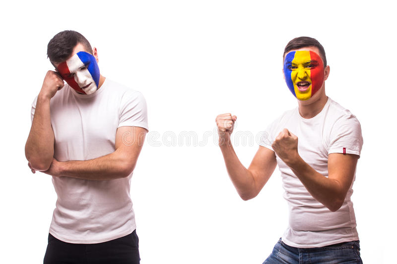 France vs Romania on white background. Football fan of Romania and France national teams show emotions: Romanian win, France los royalty free stock photography