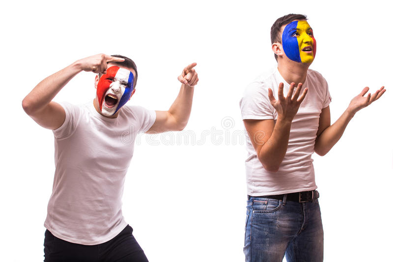 France vs Romania on white background. Football fans of Romania and France national teams demonstrate emotions: Romanian lose, Fr. Ance win football fans concept stock photos