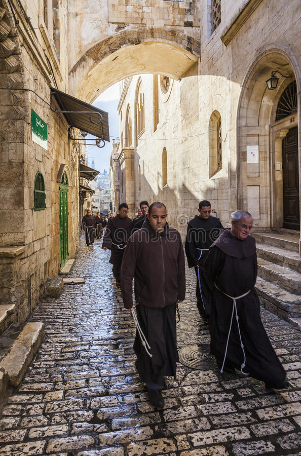 Franciscan Fathers on via Dolorosa procession. Jerusalem. Israel. Unidentified Fathers from Franciscan Order on traditional Friday Via Dolorosa (way of sorrows stock image