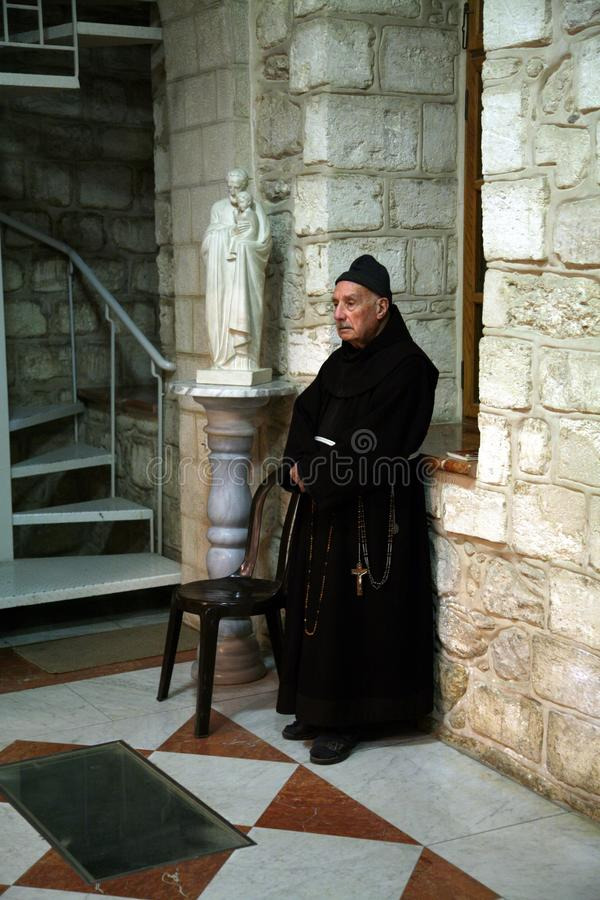 Franciscan monk in the Church of Jesus` first miracle in Cana stock photos